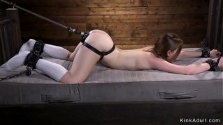 Girl Tied Up to Bed Frame Fucks Machine